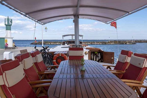 Seating on deck aboard luxury hotel barge, Athos