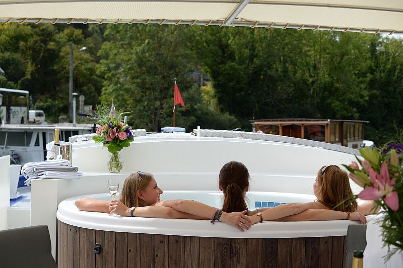 Deck-top spa pool aboard luxury hotel barge, Finesse- European Canal Cruises