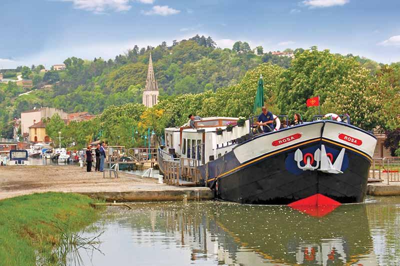 Luxury hotel barge, Rosa cruising the Canal de Garonne