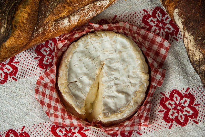 Baked Camembert served with Port and redcurrant sauce served with crusty bread