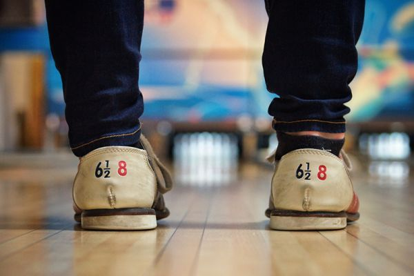 Person wearing bowling shoes on a family excursion