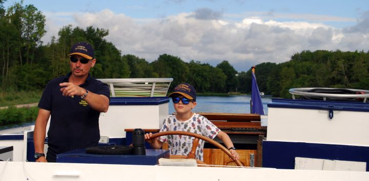 Cruises for Kids - Driving the barge