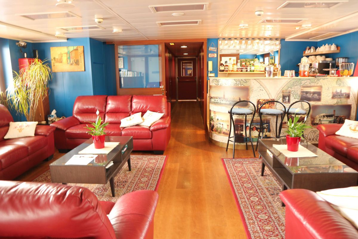 The spacious saloons aboard La Bella Vita, luxury hotel barge cruise