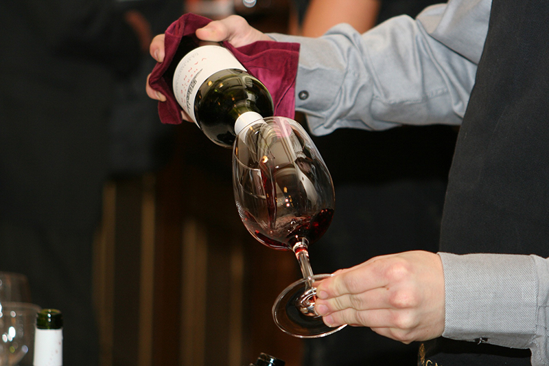 Expert wine specialists serve a selection of hand-picked wines onboard