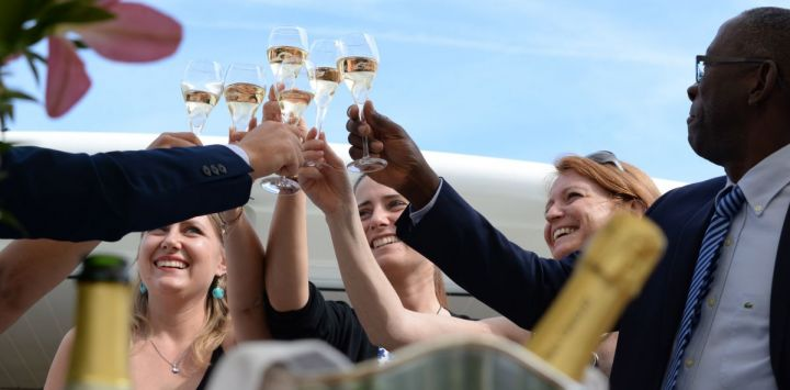 Luxury hotel barge guests celebrating aboard Finesse in Burgundy, France