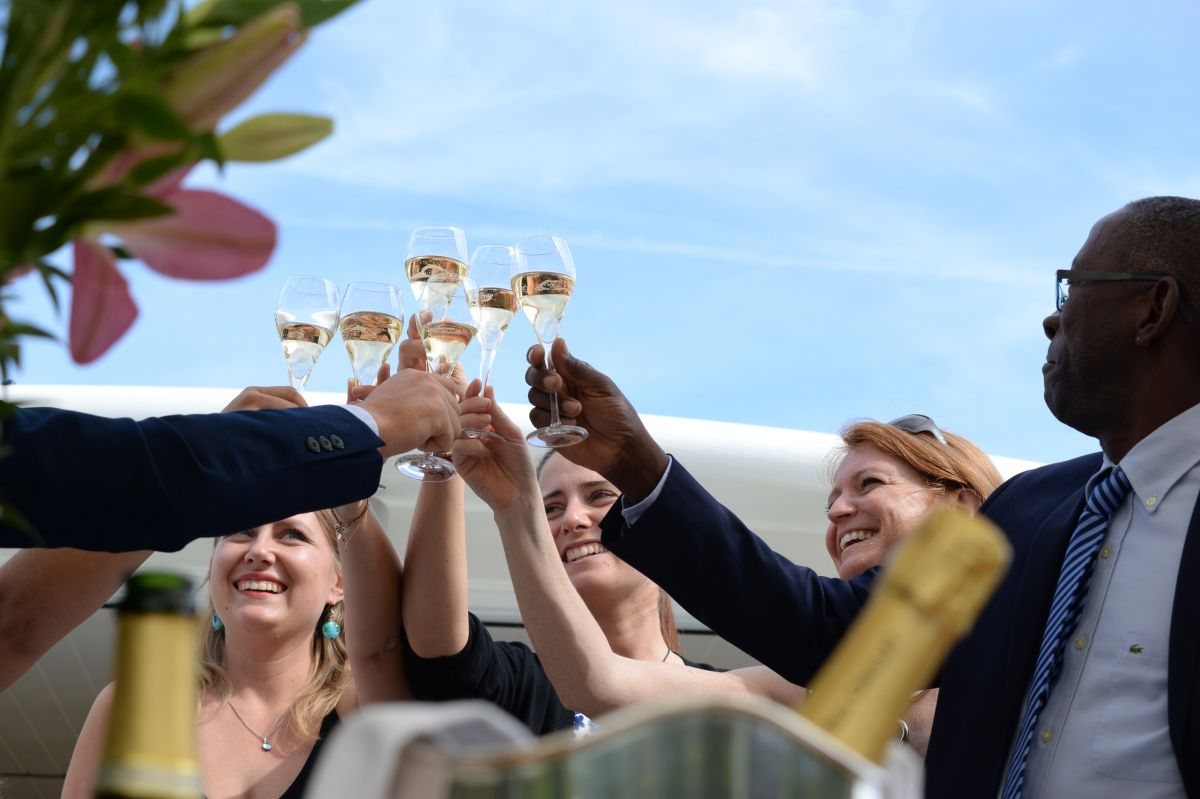 People celebrating aboard luxury barge cruise, Finesse in Burgundy France