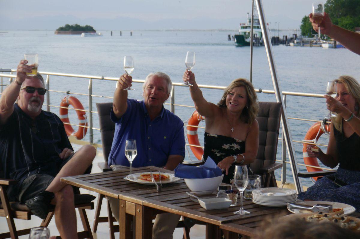 Toasting to friends aboard La Bella Vita in Italy
