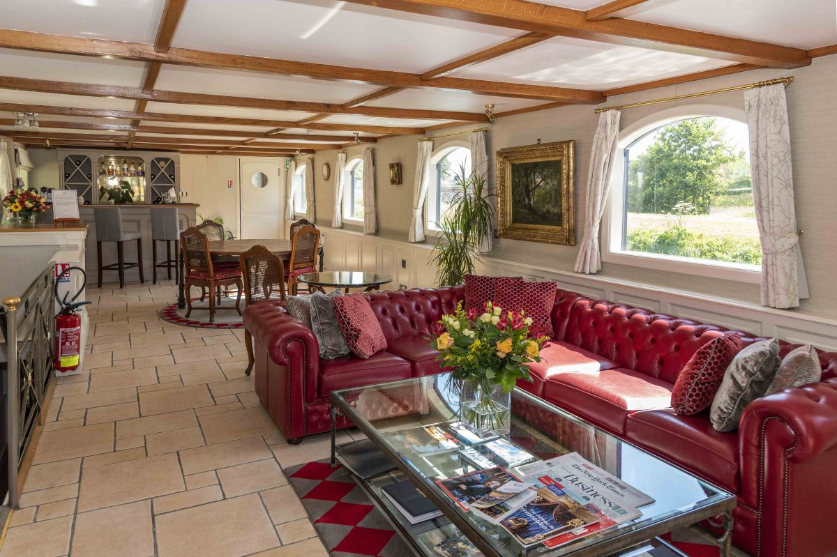 The spacious saloon aboard Renaissance luxury hotel barge, in the Upper Loire and Western Burgundy, France