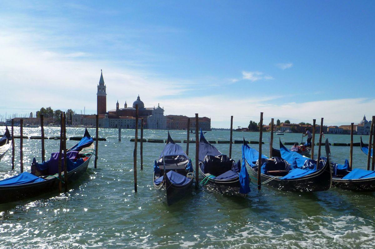 Venice gondolas bobbing in the Venetian lagoon waiting for a famous venice gondola ride