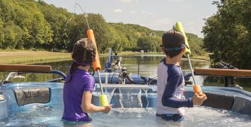 Children having fun on a luxury barge cruise through France