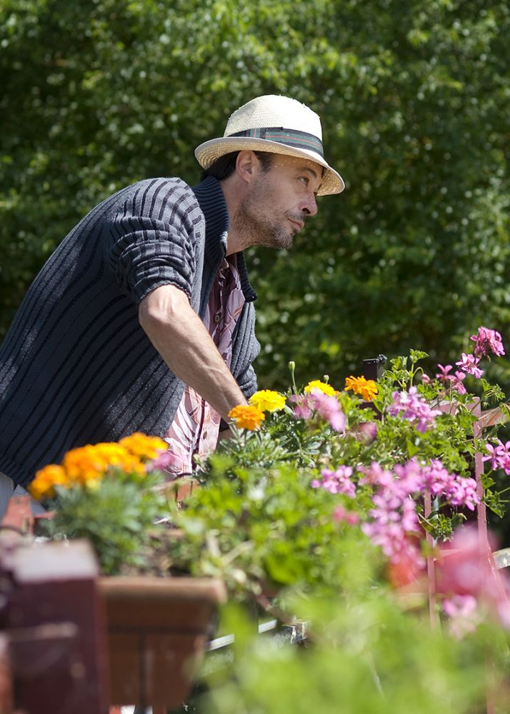 A French Lock Keeper tending to his gardens, whilst waiting for European Waterways luxury barge cruises