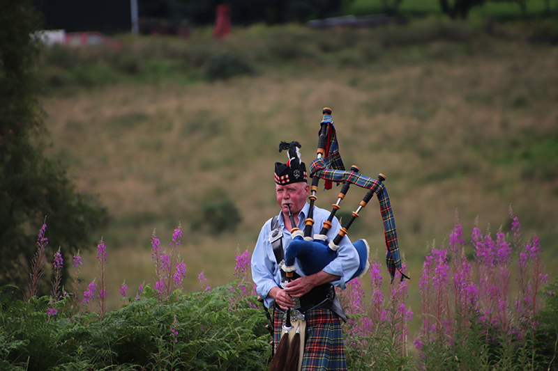 Dave Annis shares his phot of a Scottish piper playing his bagpipes along the banks of the Caledonian Canal in the Scottish Highlands