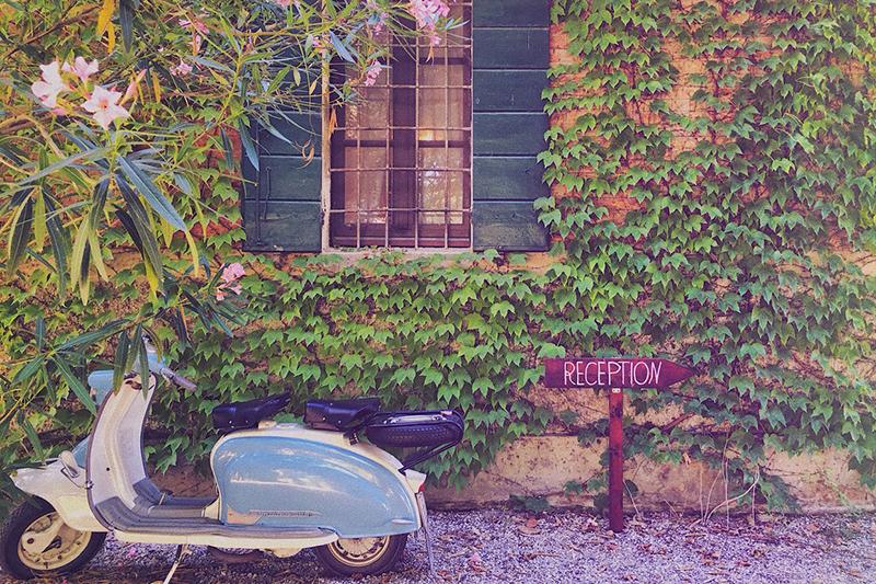 A Vespa parked outside Villa Ca'Zen, a highlight on our La Bella Vita cruise itinerary