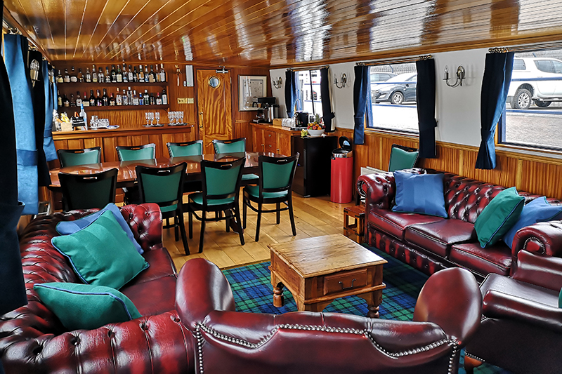 The cosy interiors of the Scottish Highland luxury barge