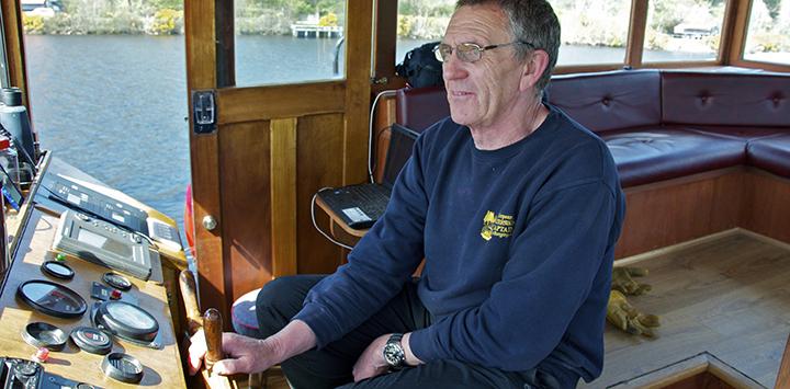 Scottish Highlander barge Captain, Mick Forster in the wheelhouse