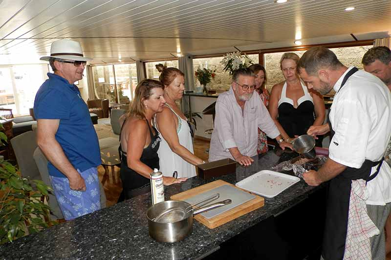 Cooking demonstration aboard luxury hotel barge, Finesse
